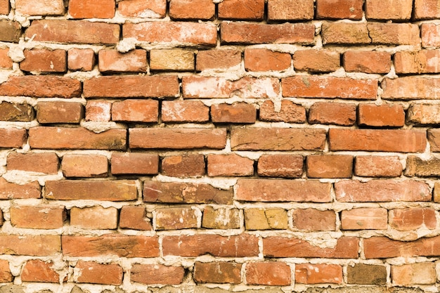 Rough brick wall with concrete Free Photo