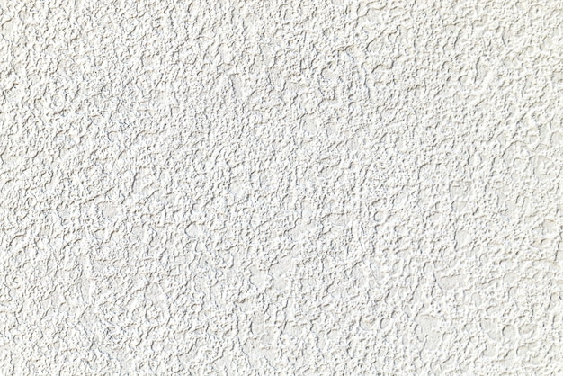 Rough white cement plastered wall texture Free Photo