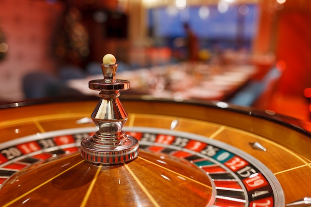 Roulette, chips and ball for the casino in the interior of the club. Premium Photo