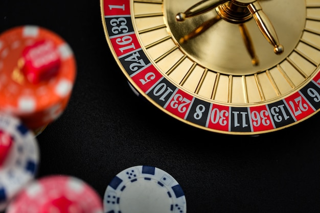 Roulette wheel gambling in a casino table Premium Photo