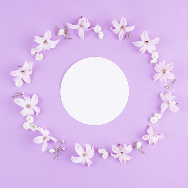Round blank paper in frame of flowers Free Photo