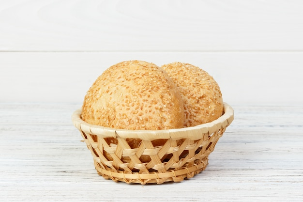 Round buns with seeds. bread in the basket. Premium Photo