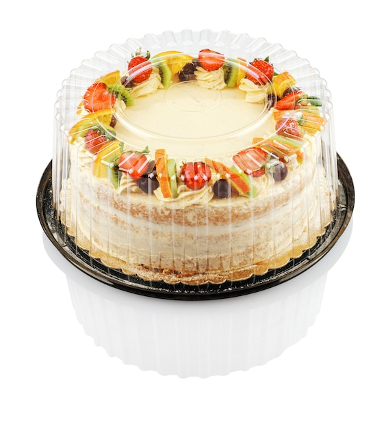 分離されたプラスチック容器にフルーツとベリーの丸いケーキ Premium写真
