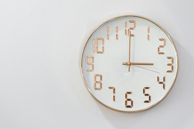 Round clock isolated on white background Premium Photo