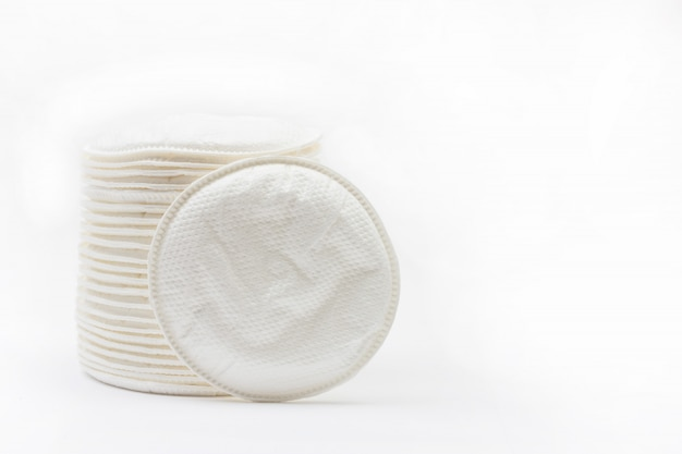 Round cotton swabs inserts bra for nursing mothers on white  with copyspace Premium Photo