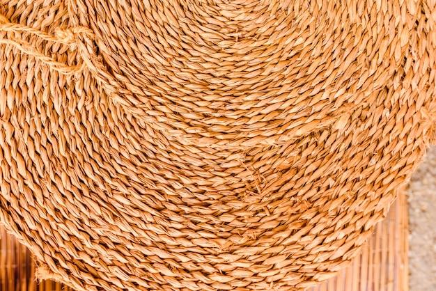 Round esparto mat, natural fiber background. Premium Photo