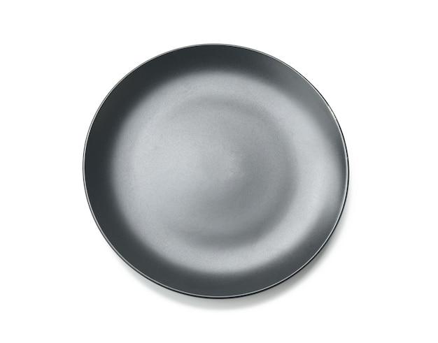 Круглая серая тарелка для основных блюд изолирована Premium Фотографии