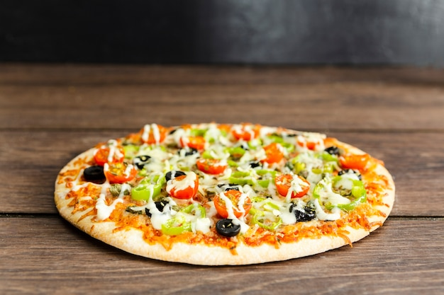 Round italian pizza with topping Free Photo