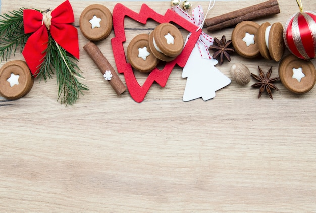 Rounded holiday cookies and decorative elements.empty space for text.flat lay top view Premium Photo