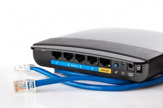 Router and ethernet cable Premium Photo