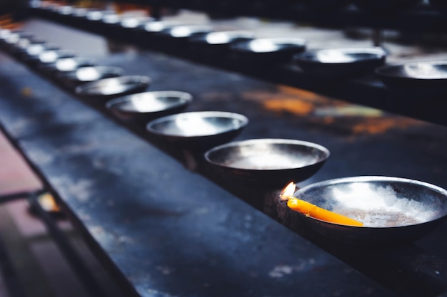 A row of candle holder in temple Premium Photo