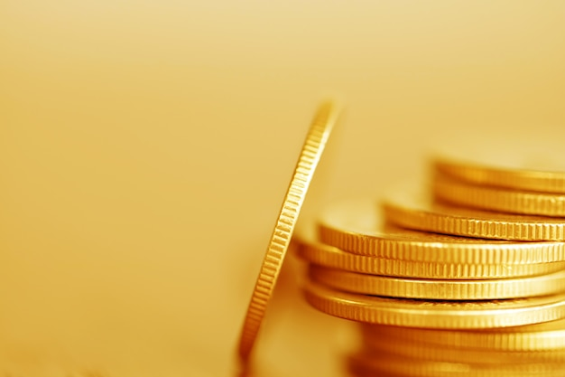 Row of coins on wood background for finance Premium Photo