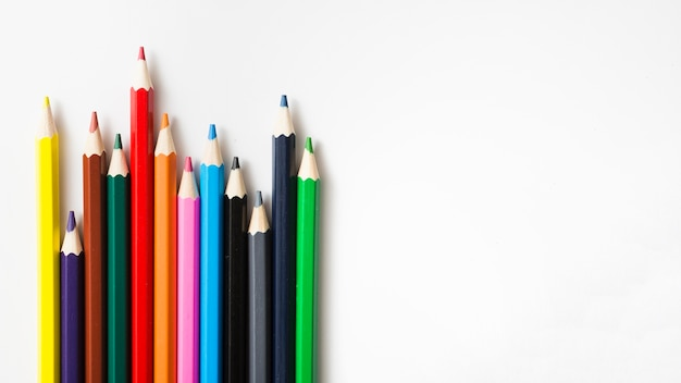 Row of colored sharp pencils against white background Free Photo