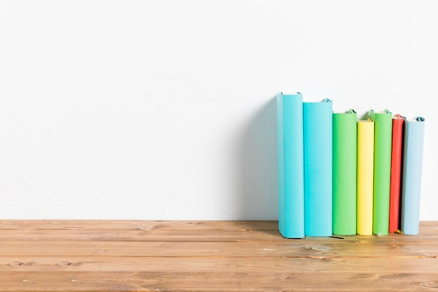 Row of colorful books on table Premium Photo