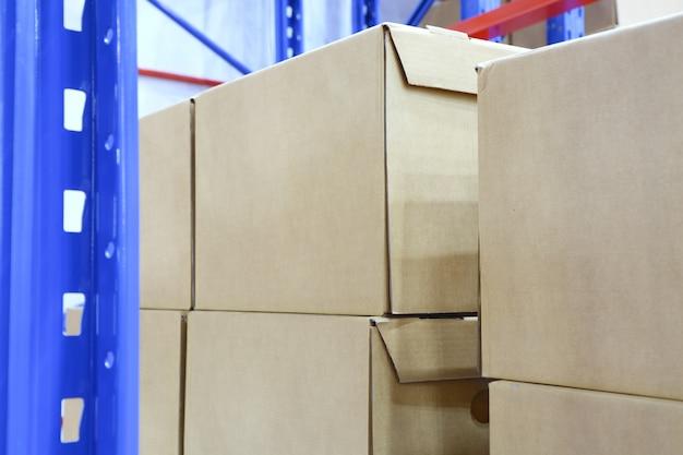 Row of cotton boxes kept in warehouse shelves ; Premium Photo