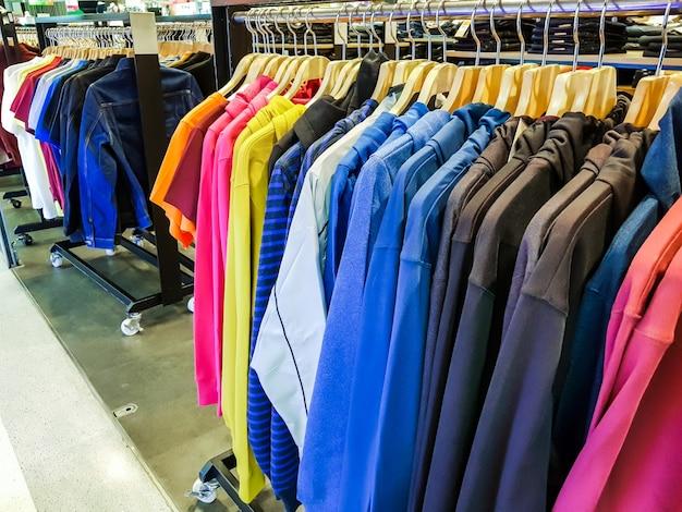 Row of fashionable clothing on hangers . Free Photo