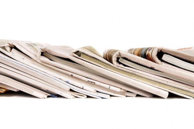 Row of folded newspapers Free Photo