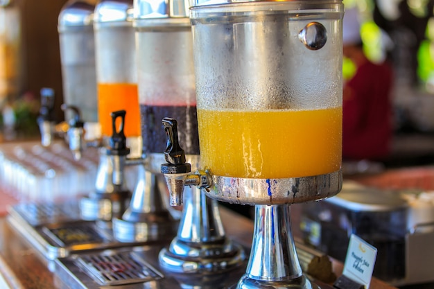 Row of fresh juice at buffet restaurant, juice buffet self service in morning at hotel Premium Photo
