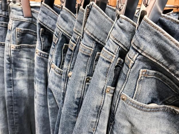 Row of hanged blue jeans pants Premium Photo