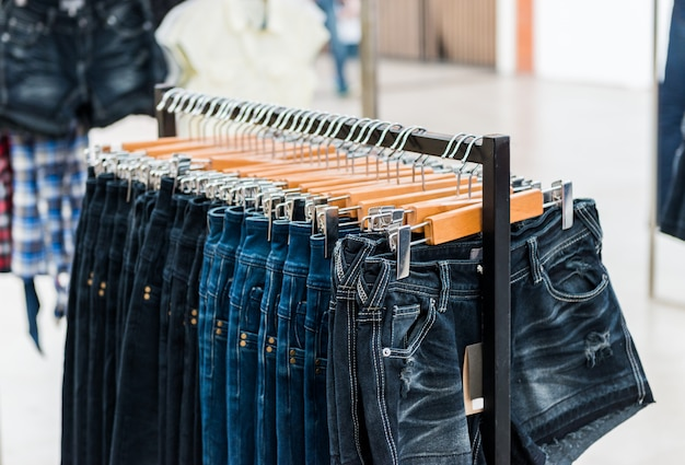 Row of hanged blue jeans Premium Photo