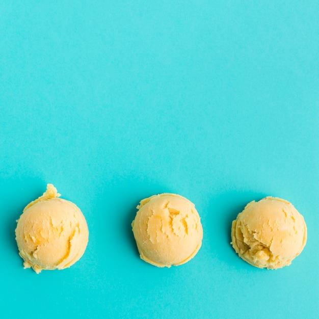 Row of mango ice cream scoops Free Photo