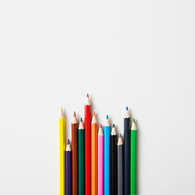 Row of sharp colored pencils against white background Free Photo