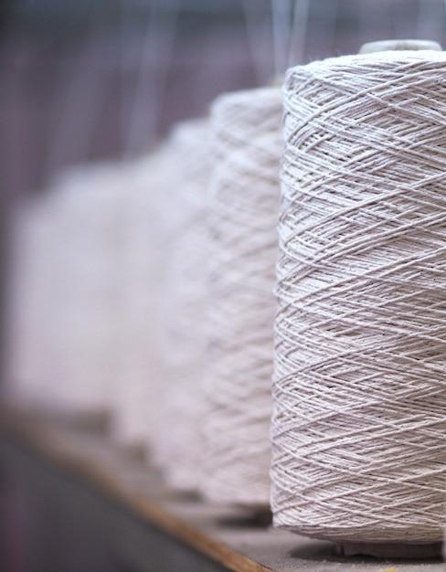 Row of textile threads industry Premium Photo
