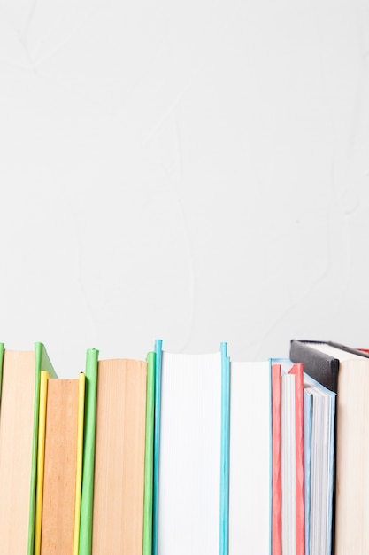 Row of various colorful books Free Photo