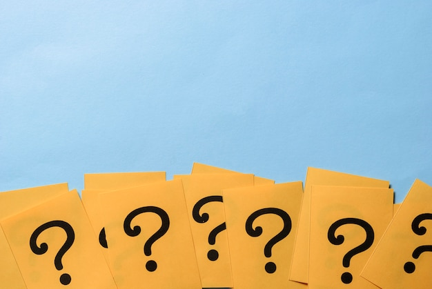 Row of yellow question marks forming a border Premium Photo