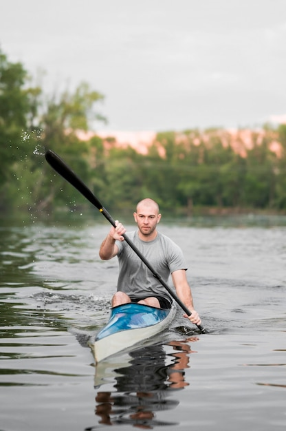 Rowing concept with man in kayak Free Photo