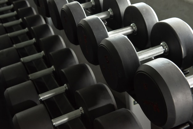 Rows of dumbbell used to exercise in the training gym. Premium Photo
