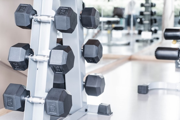 Rows of dumbbells in gym Premium Photo