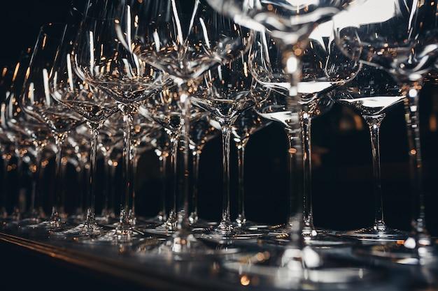 Rows of empty wine glasses Premium Photo
