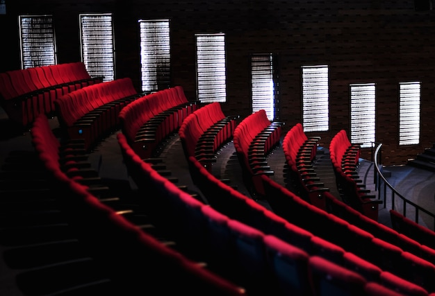 Rows of red seats in a theater Free Photo