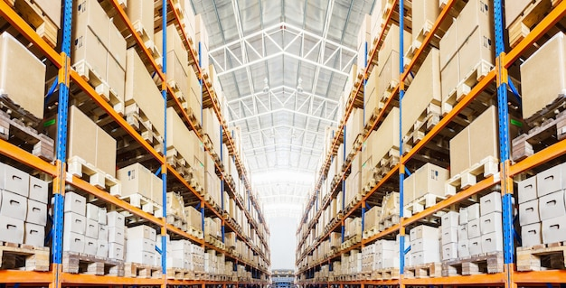 Rows of shelves with boxes in modern warehouse Premium Photo