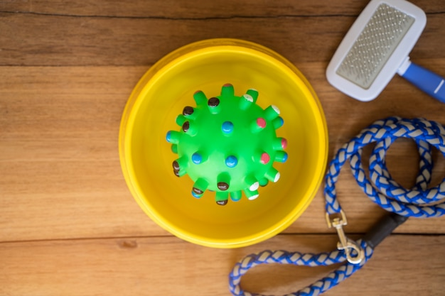 Rubber toy with supplies on wooden. pet accessories concept Premium Photo