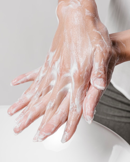 Rubbing hands with water and soap Free Photo