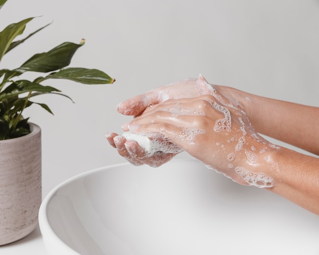 Rubbing soap in hands for a good clean Premium Photo