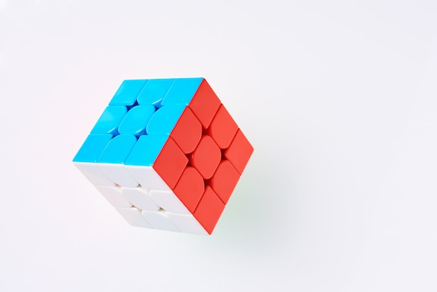 Rubics cube on a white background, top view Premium Photo