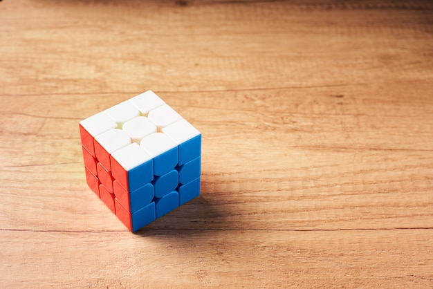 Rubics cube on a wooden background, top view Premium Photo
