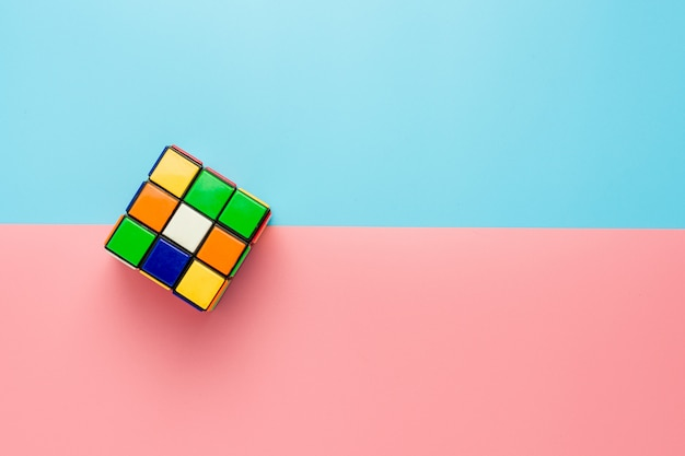 Rubik's cube on pink and blue background. Premium Photo