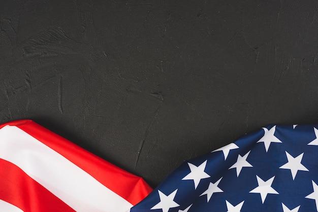 Ruffled us flag on texture background Free Photo
