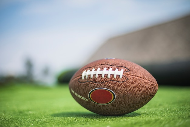 Rugby ball on green turf Free Photo