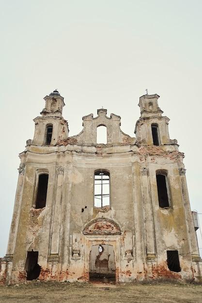 Ruins of an old european catholic church on an autumn afternoon Premium Photo