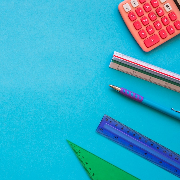 Rulers and pen near calculator Free Photo