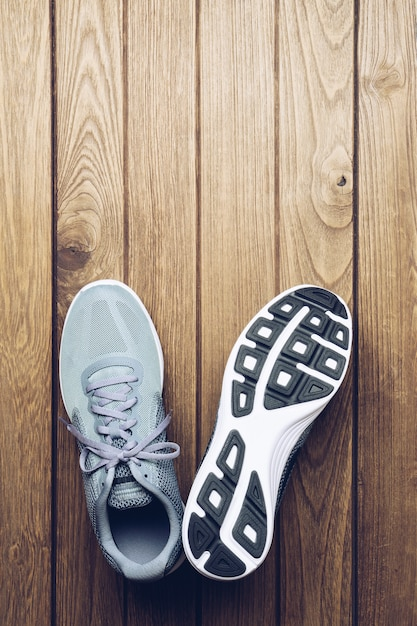Running sport shoes on wooden background top view with copy space. Premium Photo
