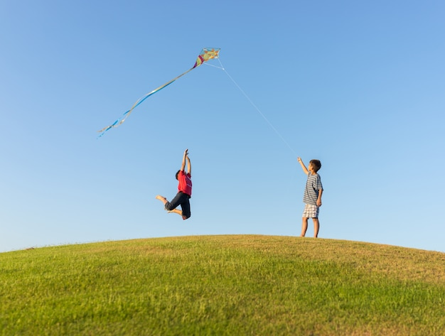 Running with kite on summer holiday vacation, perfect meadow and sky on seaside Premium Photo