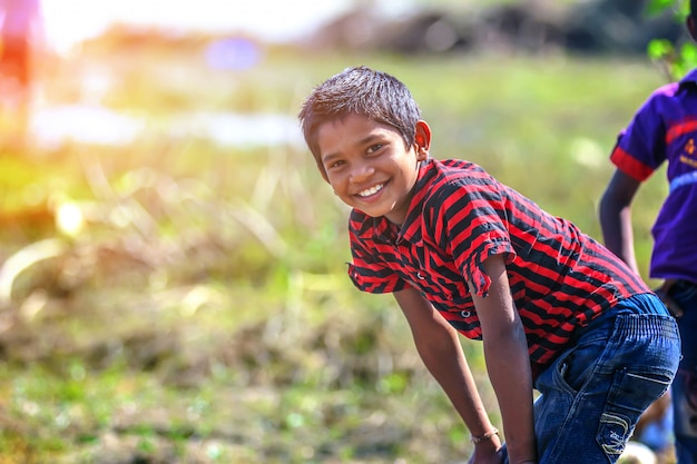 Rural indian child playing in river Premium Photo