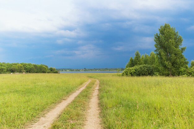 Rural landscape with country road, the sky before the storm Premium Photo
