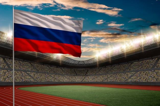 Bandiera russa davanti a uno stadio di atletica leggera con i fan. Foto Gratuite
